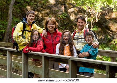 Visitors View McHugh Crk From Foot Bridge SC Alaska Summer Chugach SP - Stock Photo