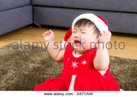 Asian baby girl with xmas dressing at home - Stock Photo