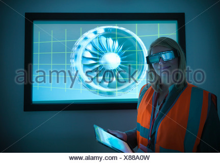 Scientist wearing 3D glasses in lab - Stock Photo