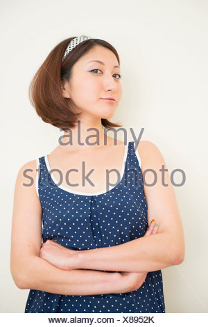 Woman wearing polka dots in haughty pose - Stock Photo