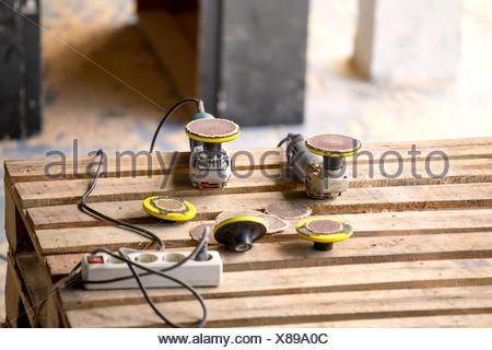 Random orbital sanders and multiple socket - Stock Photo