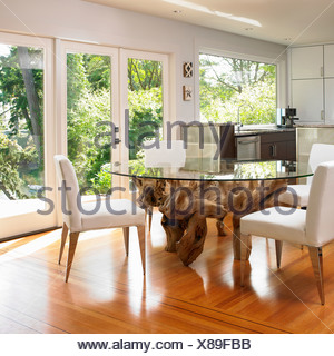 Glass Topped Dining Table With Large Tree Root Base Victoria Vancouver Island British Columbia