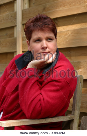 Adult plus sized woman in thoughts contemplating outside - Stock Photo