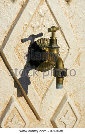 Old water tap on a wall, Altea, Costa Blanca, Spain - Stock Photo