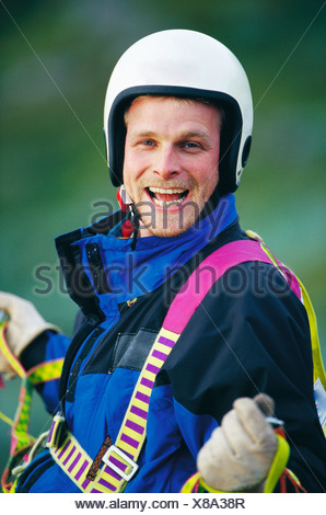 Portrait of paraglider laughing - Stock Photo