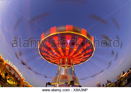 Chairoplane on fun fair - Stock Photo