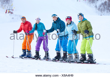 Young people in skiing resort - Stock Photo