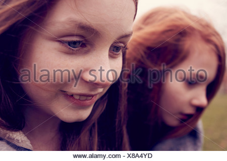 Close up of young friends outdoors - Stock Photo