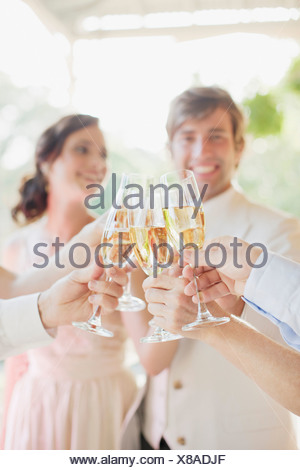 Guests toasting with champagne at wedding reception - Stock Photo