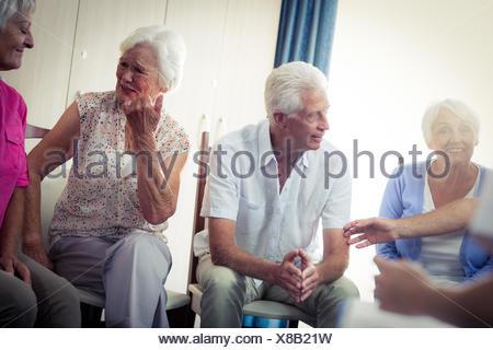 Seniors interacting - Stock Photo