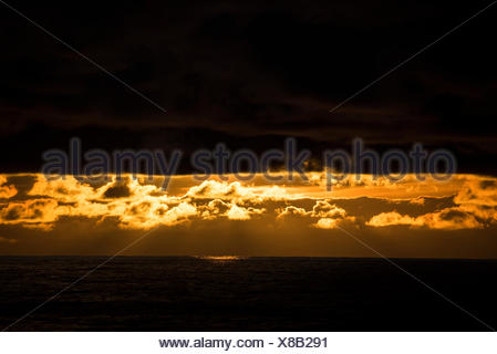 Sunset on the open water heading to the Falkland Islands. - Stock Photo