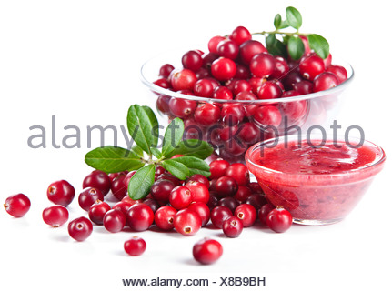 Glass bowl with cranberries on white background - Stock Photo