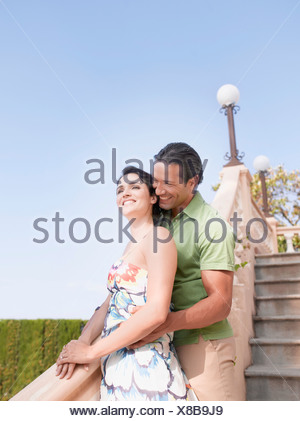 Couple hugging on staircase - Stock Photo