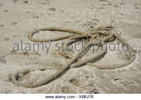 Ropes washed ashore  Spiekeroog  East Frisian Island  North Sea  Germany - Stock Photo