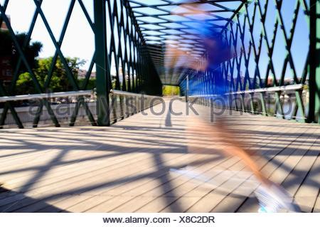 Corridor by an iron bridge over the river Manzanares in Madrid - Stock Photo