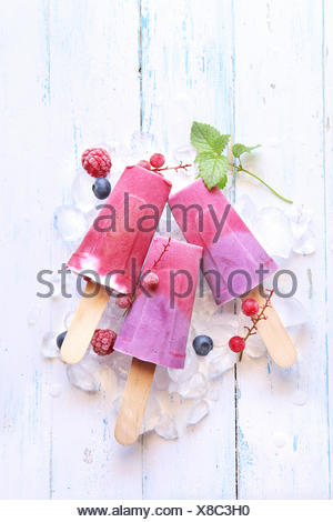 Summer ice cream popsicles with blueberry, raspberry and yogurt - Stock Photo