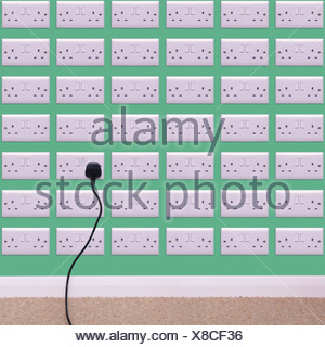 Wall covered in electrical outlets - Stock Photo