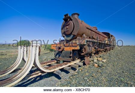 an old steam engine lies rusting at the end of the line  In the Great Karroo, South Africa - Stock Photo