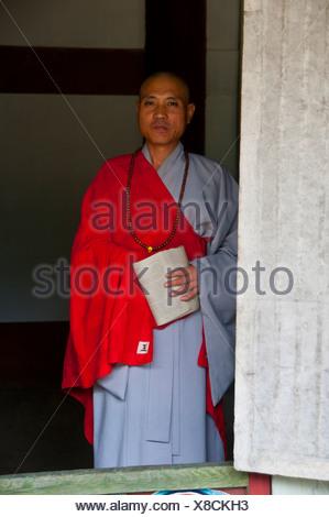 Elderly monk at the Buddhist Pohyon Temple on Mount Myohyang-san, North Korea, Asia Stock Photo