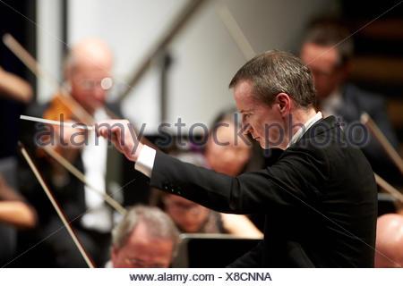 Principal Conductor Garry Walker conducts, Staatsorchester Rheinische Philharmonie, Rhein-Mosel-Halle, Koblenz - Stock Photo