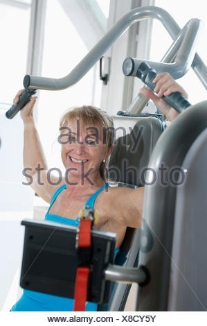 Portrait mature woman fitness studio smiling happy - Stock Photo