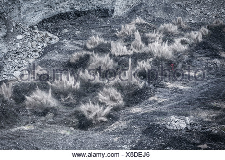 Blasting explosion in surface coal mine - Stock Photo
