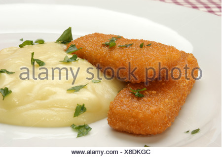 Fish fingers with mashed potatoes on a plate - Stock Photo