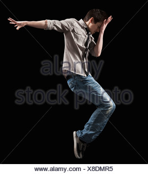 Male dancer jumping in the air - Stock Photo