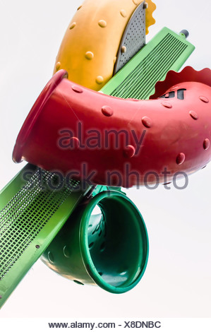 Red green and yellow plastic tubes on white background - Stock Photo
