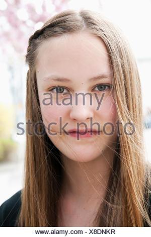 Sweden, Vastra Gotaland, Gothenburg, Vasastaden, Portrait of pensive teenage girl (14-15) - Stock Photo