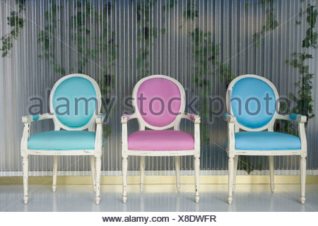 Three chairs in a row - Stock Photo