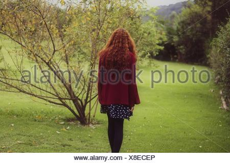 Rear View Of Woman In Park - Stock Photo