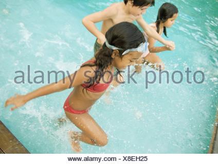 Children in swimming pool - Stock Photo