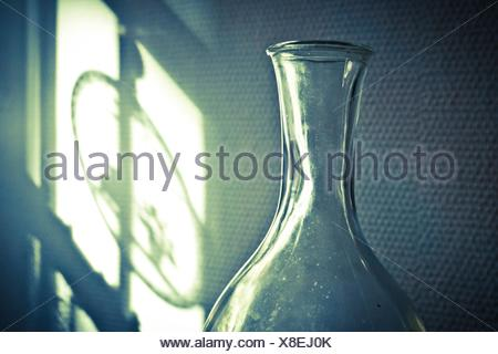 Tall transparent glass jug, interior. - Stock Photo