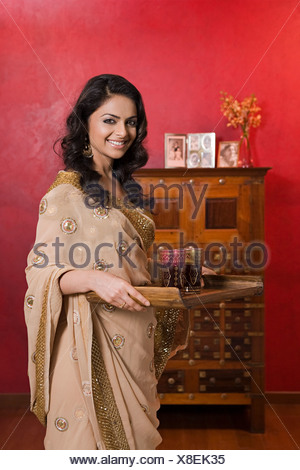 A woman carrying a tray - Stock Photo