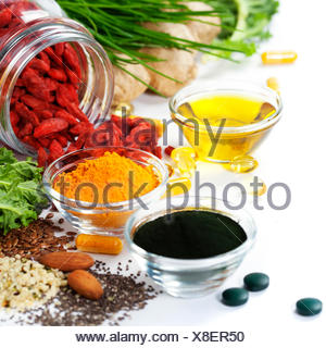 Alternative natural medicine. Dietary supplements. Spirulina, turmeric  and organic oil on white background. Superfood, detox or - Stock Photo