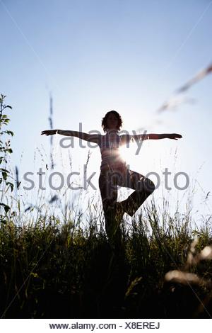 Woman Performing Yoga - Stock Photo