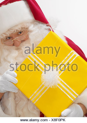 Santa with a present - Stock Photo