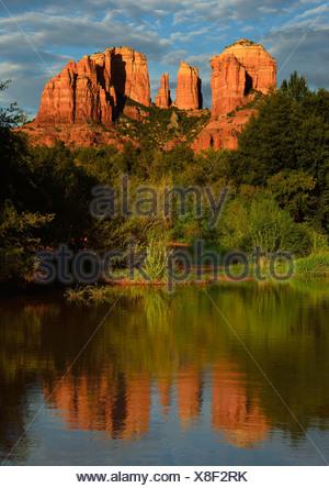 Reflection of Cathedral Rock in Oak Creek River, evening light, Oak Creek Canyon, Sedona Arizona, Southwest - Stock Photo