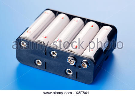 Batteries in battery charger - Stock Photo