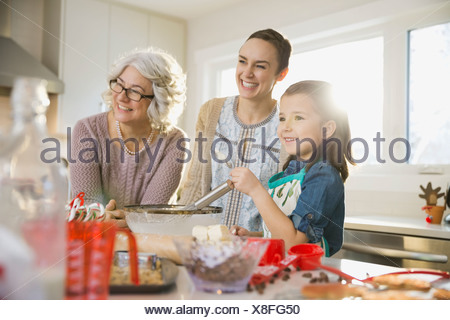 Three generation family baking cookies at Christmas - Stock Photo