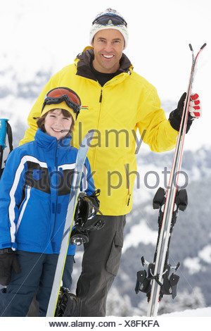 Father And Son On Ski Holiday In Mountains - Stock Photo