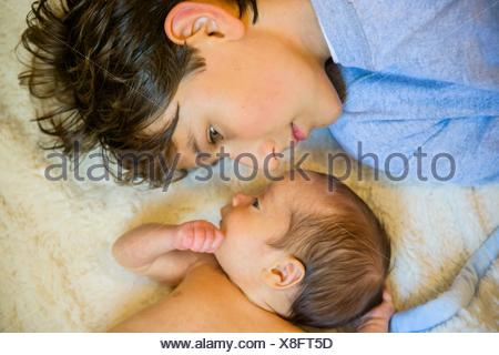 Big brother with baby brother - Stock Photo