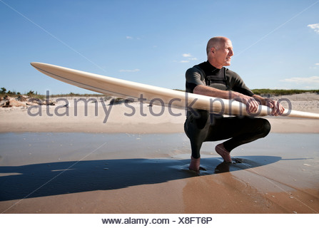 Surfer looking away, portrait - Stock Photo