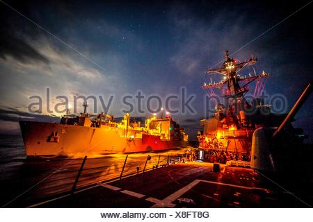 SEA OF JAPAN (Nov. 16, 2016) The forward-deployed Arleigh Burke-class guided-missile destroyer USS Barry (DDG 52) conducts an underway-replenishment - Stock Photo