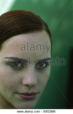 Woman looking at camera, portrait - Stock Photo