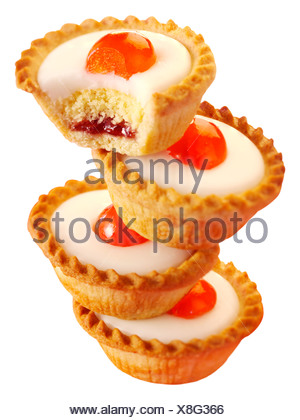 CHERRY BAKEWELL TARTS CUT OUT - Stock Photo