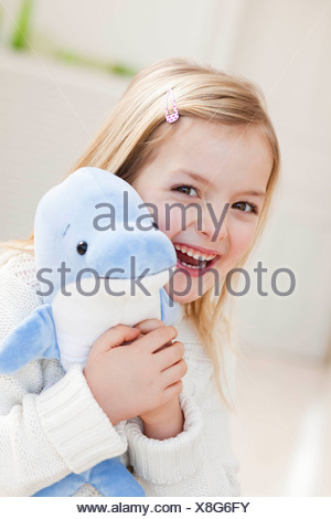young girl with dolphin - Stock Photo