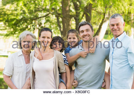 Portrait of a happy extended family in park