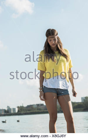 Young woman wearing yellow top and hot pants - Stock Photo